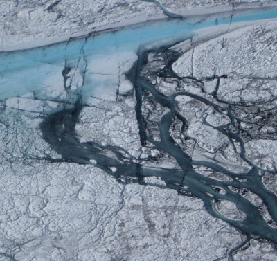 A 5- to 10-meter stream of meltwater flows on the Greenland icecap