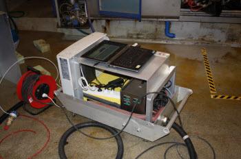 FTIR analyzer in bespoke tray.