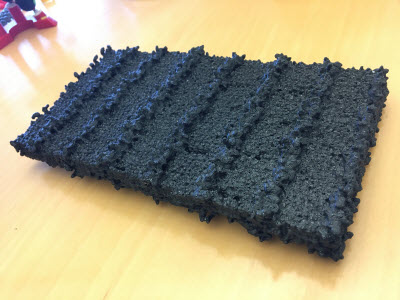 A 3-D-printed model of a peptoid nanosheet, showing patterned rows of sugars