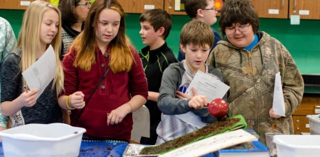 students learning about landslides