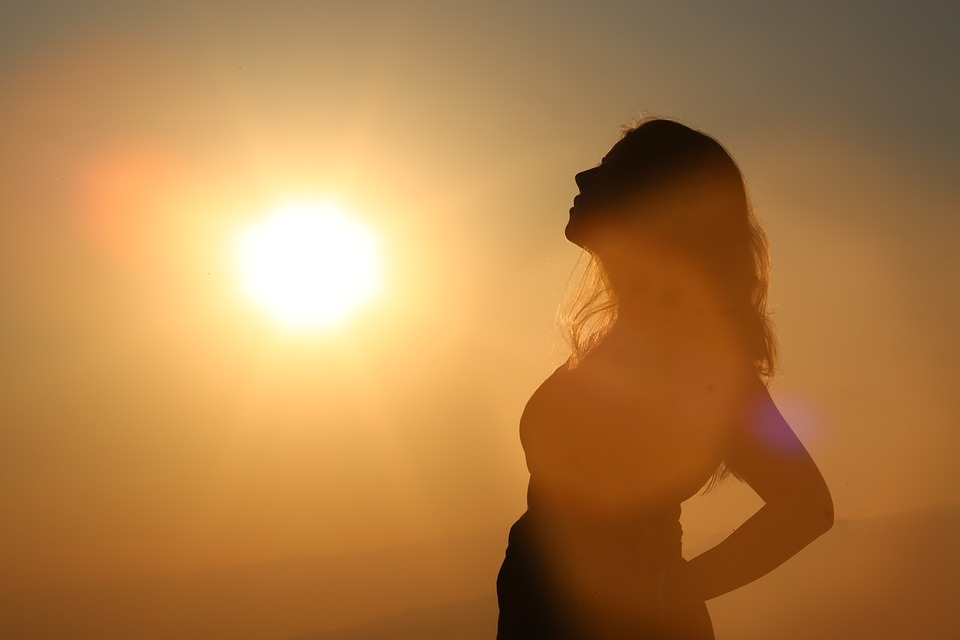 Woman standing in the sunshine