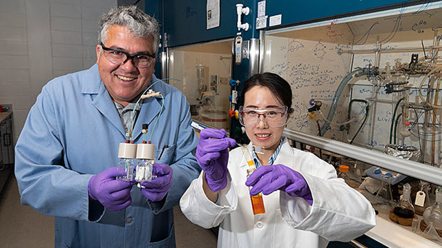 Brookhaven Lab chemist Javier Concepcion and Lei Wang, a graduate student at Stony Brook University