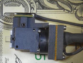 miniature microscope with money