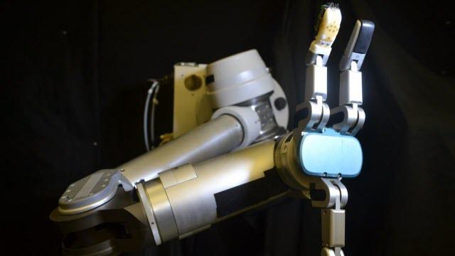 flexible sensor skin wrapped around the robot finger
