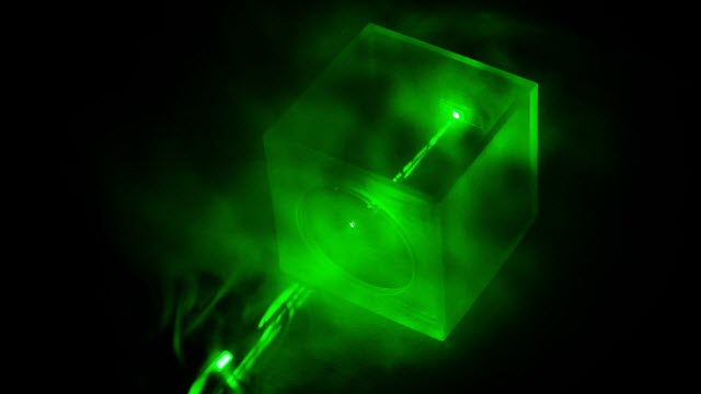 A Laser Shining on the Special Chip Designed by the NTU Researchers