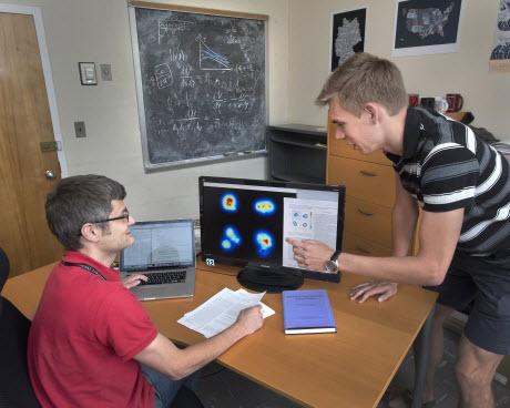 Brookhaven Lab nuclear theorists Björn Schenke and Heikki Mäntysaari
