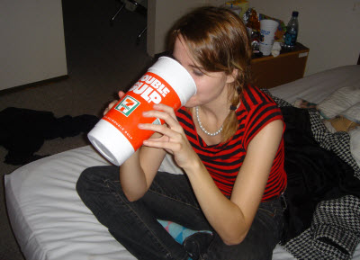 girl drinking large soda