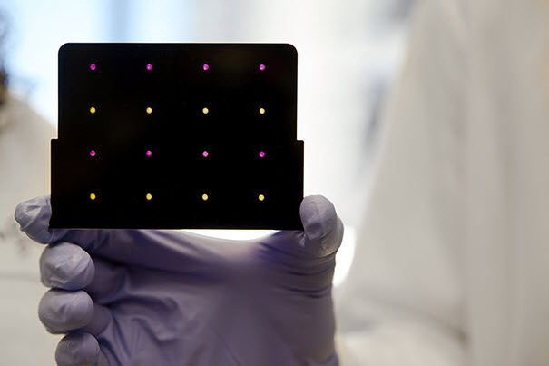 A black cartridge containing a paper-based diagnostic for detecting the Zika virus
